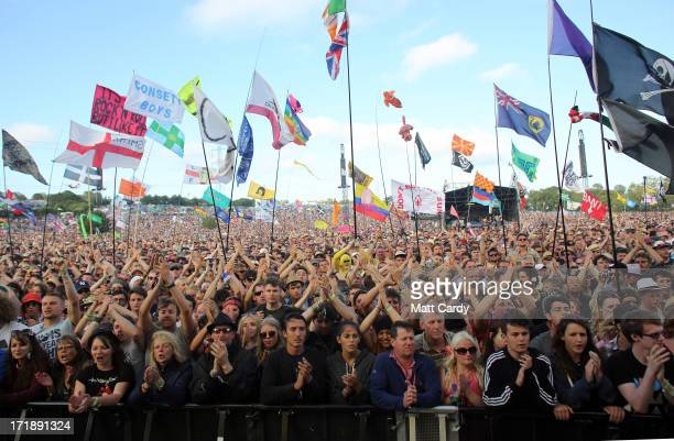 Music fans cheer as Primal Scream perform on the Pyramid Stage at the Glastonbury Festival of Contemporary Performing Arts site at Worthy Farm Pilton...