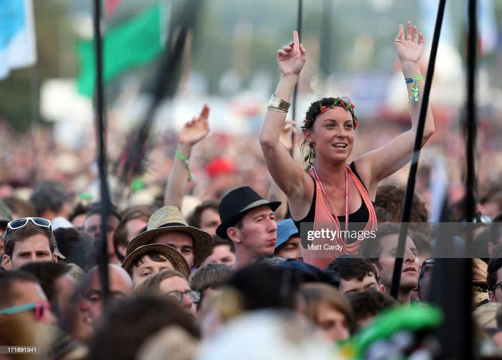 Music fans cheer Primal Scream perform on the Pyramid Stage at the Glastonbury Festival of Contemporary Performing Arts site at Worthy Farm, Pilton on June 29, 2013 near Glastonbury, England. The wholesale market caters for traders throughout the Festival who are estimated to provide 3 million meals for festival-goers, crew and performers. Gates opened on Wednesday at the Somerset diary farm that will be playing host to one of the largest music festivals in the world and this year features headline acts Artic Monkeys, Mumford and Sons and the Rolling Stones. Tickets to the event which is now in its 43rd year sold out in minutes and that was before any of the headline acts had been confirmed. The festival, which started in 1970 when several hundred hippies paid 1 GBP to watch Marc Bolan, now attracts more than 175,000 people over five days.
