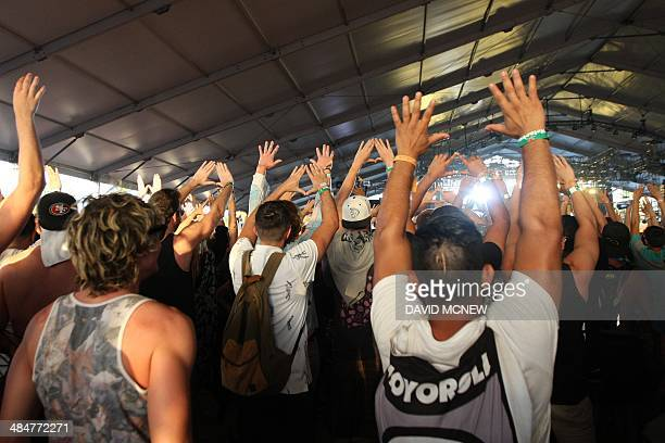 Music fans dance at the Coachella Valley Music Arts Festival at the Empire Polo Club in Indio California April 13 2014 The annual music festival...
