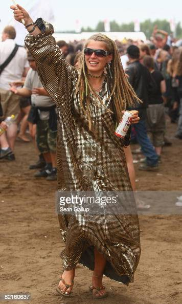 Music fans dance at the International Woodstock Festival on August 2 2008 in Kostrzyn Poland Hundreds of thousand of fans attend the annual festival...