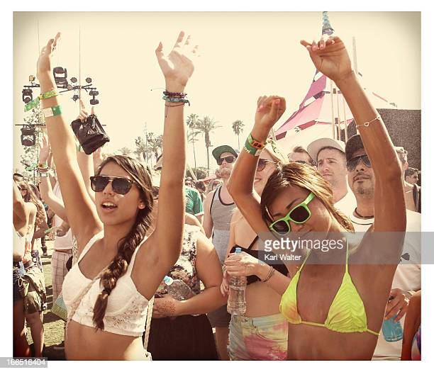 Music fans dance during day 1 of the 2013 Coachella Valley Music Arts Festival at the Empire Polo Club on April 13 2013 in Indio California