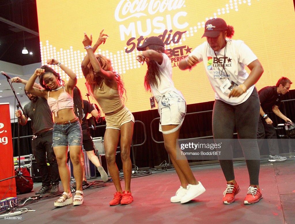 Music fans dance onstage at the Coke music studio during the 2016 BET Experience on June 25, 2016 in Los Angeles, California.