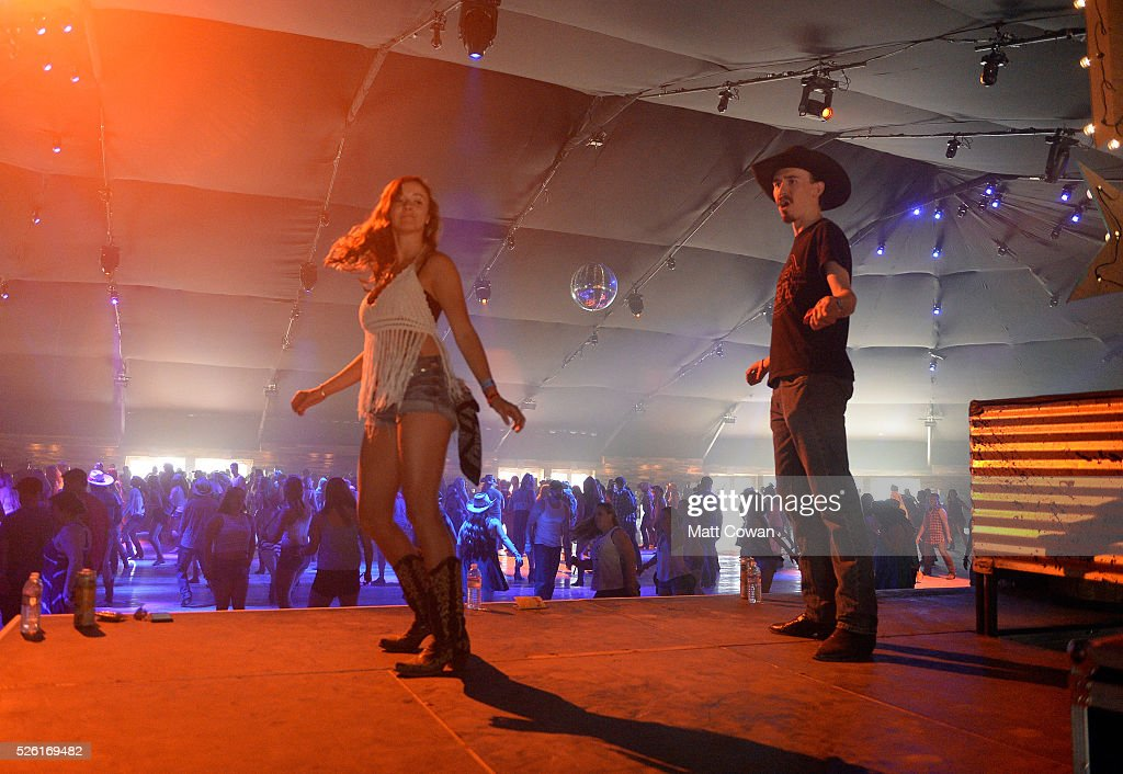 Music fans dance onstage during the performance of DJ Jack at 2016 Stagecoach California's Country Music Festival at Empire Polo Club on April 29, 2016 in Indio, California.