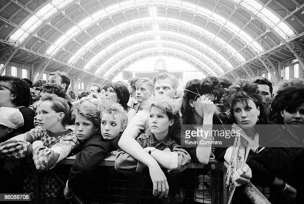 Music fans during a performance by English rock group The Fall at the GMEX centre Manchester during the Festival Of The 10th Summer 19th July 1986...