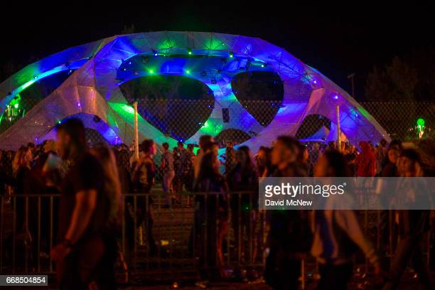 Music fans gather at the Silent Disco while camping out at the Empire Polo Club on the eve of the 2017 Coachella Valley Music And Arts Festival on...