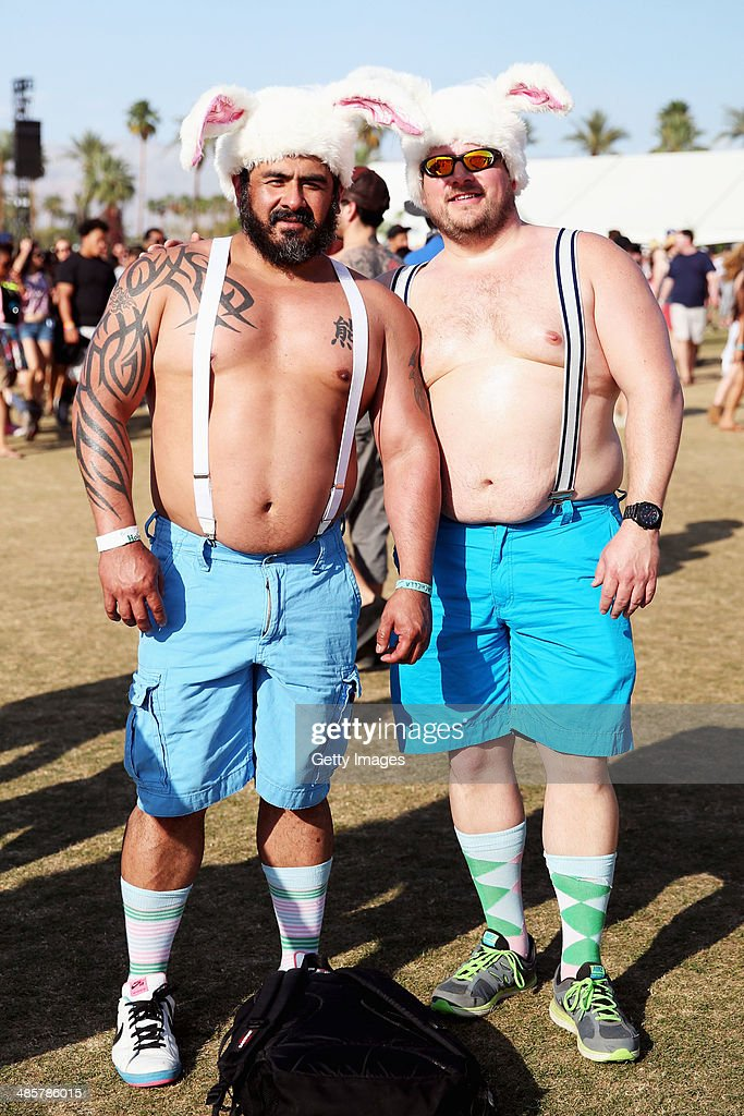 Music fans Julio Selgado (L) of San Fransisco and Kyle Griffin of Minnesota attend day 3 of the 2014 Coachella Valley Music & Arts Festival at the Empire Polo Club on April 20, 2014 in Indio, California.