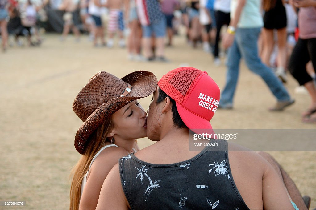 Music fans kiss during 2016 Stagecoach California's Country Music Festival at Empire Polo Club on May 01, 2016 in Indio, California.