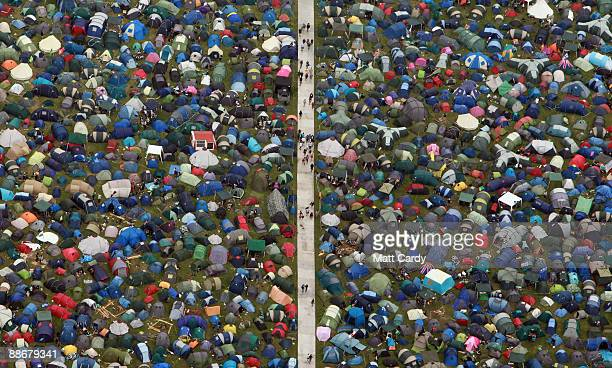 Music fans move around the tents at the Glastonbury Festival site at Worthy Farm Pilton on June 25 2009 in Glastonbury Somerset England The gates...