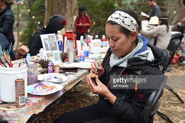 Music fans paint pet rocks at Digital Detox Analog Zone during day 2 of the 2014 Outside Lands Music and Arts Festival at Golden Gate Park on August...