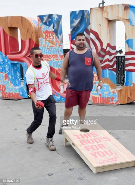 Music fans play cornhole toss in the Bud Block area during the 2017 Budweiser Made in America festival Day 1 at Benjamin Franklin Parkway on...