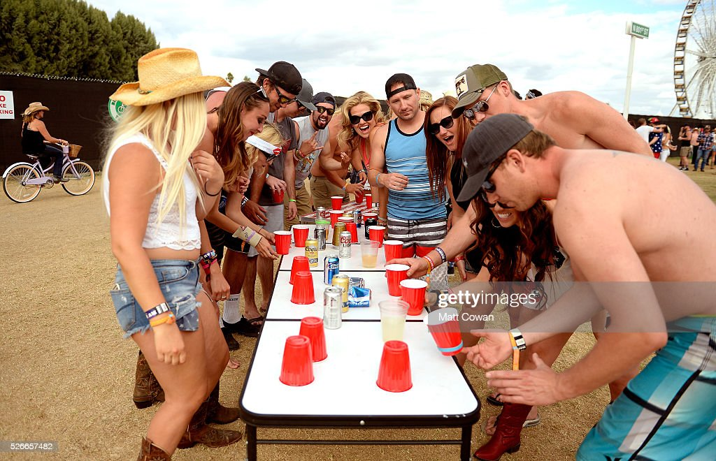 Music fans play drinking games during 2016 Stagecoach California's Country Music Festival at Empire Polo Club on April 30, 2016 in Indio, California.