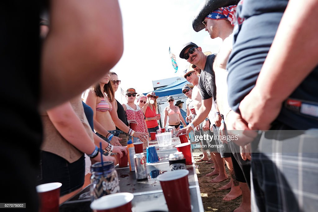 Music fans play drinking games during 2016 Stagecoach California's Country Music Festival at Empire Polo Club on May 01, 2016 in Indio, California.