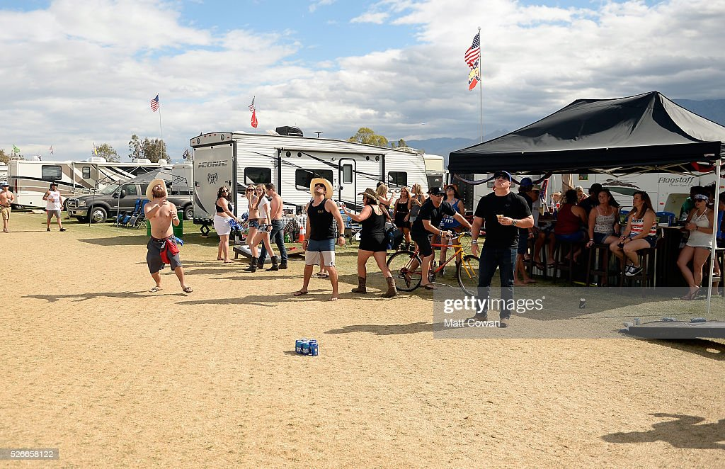 Music fans play drinking games in the RV park during 2016 Stagecoach California's Country Music Festival at Empire Polo Club on April 30, 2016 in Indio, California.
