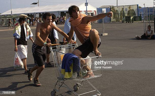 Music fans push a shopping trolly as they arrive for the International Festival of Benicassim on July 19 2007 in Benicassim Spain The festival...