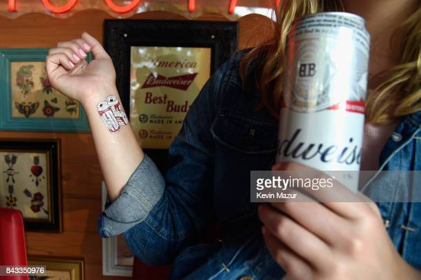 Music fans recieve temporary tattoos in the Bud Block area during 2017 Budweiser Made in America Day 1 at Benjamin Franklin Parkway on September 2...
