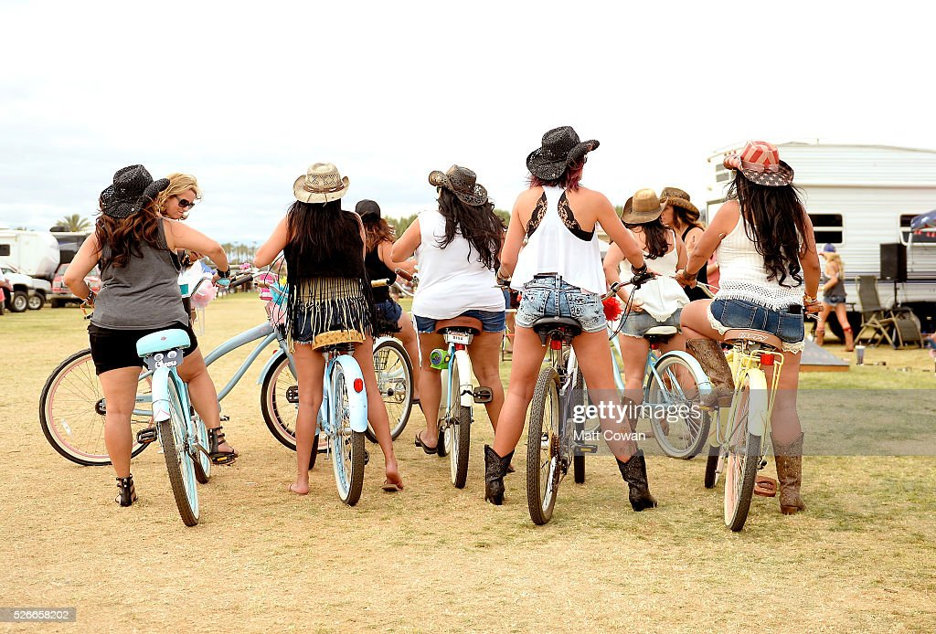 Music fans ride bicycles in the RV park during 2016 Stagecoach California's Country Music Festival at Empire Polo Club on April 30, 2016 in Indio, California.