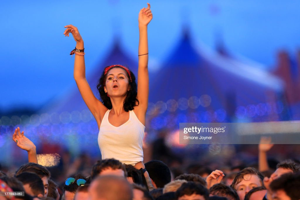Music fans soak up the atmopshere as Chase and Status perform live on the main stage during day two of Reading Festival at Richfield Avenue on August...
