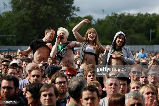 Music fans soak up the atmopshere as The Gaslight Anthem perform on stage during day one of Feis Festival 2011 at Finsbury Park on June 18 2011 in...