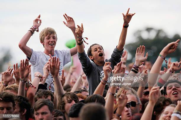 Music fans soak up the atmosphere as Two Door Cinema Club perform live on the Main Stage during day two of Reading Festival 2011 on August 27 2011 in...
