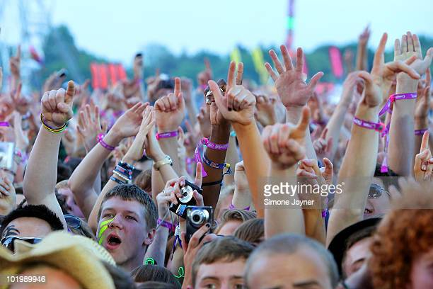 Music fans soak up the atmosphere during day one of the Isle of Wight Festival 2010 at Seaclose Park on June 11 2010 in Newport Isle of Wight The...