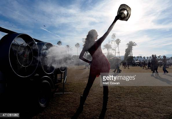 Music fans stand in the misters during day three of 2015 Stagecoach California's Country Music Festival at The Empire Polo Club on April 26 2015 in...