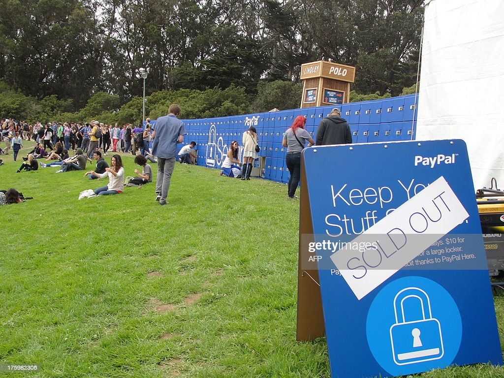 Music fans store gear in PayPal lockers installed to reduce pain points at Outside Land Music festival, on August 9, 2013 in Golden Gate Park, San Francisco. Online financial transactions titan PayPal says it is keen to collaborate with others as it strives for a cash-free future. 'We are all about working with developers to let them take advantage of the heavy lifting we've done when it comes to moving money around the world,' Hill Ferguson, the company's vice president of global product, told AFP. PayPal -- founded 15 years ago with a vision of becoming a global currency -- has also been working with stores in the United States and abroad to let people pay for almost anything with Internet-Age digital wallets. AFP PHOTO / Glenn CHAPMAN