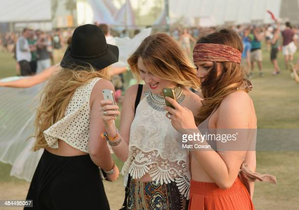 Music fans take selfies during day 2 of the 2014 Coachella Valley Music Arts Festival at the Empire Polo Club on April 12 2014 in Indio California