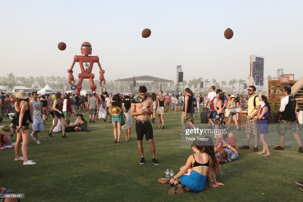 Music fans walk amongst the Becoming Human art installation (by Christian Ristow) and Balloon Chain (by Robert Base) during day 2 of the 2014 Coachella Valley Music & Arts Festival at the Empire Polo Club on April 12, 2014 in Indio, California.