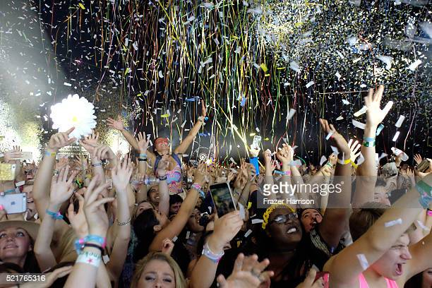 Music fans watch during day 2 of the 2016 Coachella Valley Music Arts Festival Weekend 1 at the Empire Polo Club on April 16 2016 in Indio California