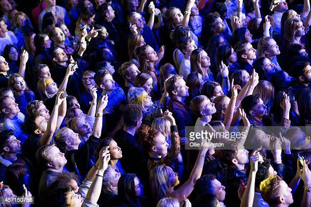 Music fans watch on as Ella Eyre performs on stage at Shepherds Bush Empire on October 10 2014 in London United Kingdom