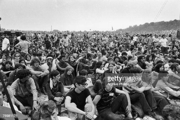 Music fans watch Richie Havens perform at the Woodstock Music and Art Fair in Bethel New York State August 1969