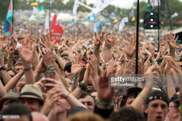 Music fans watch Royal Blood perform on the Pyramid Stage at the Glastonbury Festival of Music and Performing Arts on Worthy Farm near the village of...