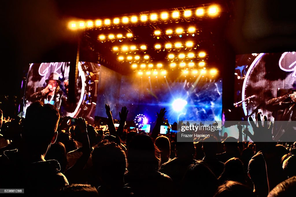 Music fans watch the Guns N' Roses performance onstage during day 2 of the 2016 Coachella Valley Music & Arts Festival Weekend 2 at the Empire Polo Club on April 23, 2016 in Indio, California.