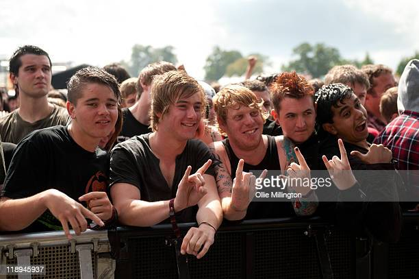 Music festival fans watching the Sum 41 performs onstage at Sonisphere Festival at Knebworth House on July 9 2011 in Stevenage England