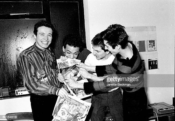 Music group Adam and the Ants clown around in the office of Do It Records tearing and biting copies of NME and Sounds two music newspapers London...