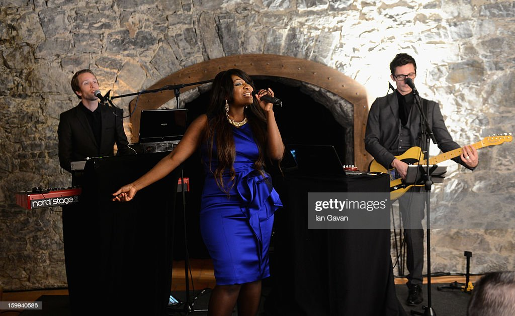 Music group Dora play live at the Excalibur Dinner hosted by Roger Dubuis during the 23rd Salon International de la Haute Horlogerie at Caves des Vollandes on January 22, 2013 in Geneva, Switzerland.