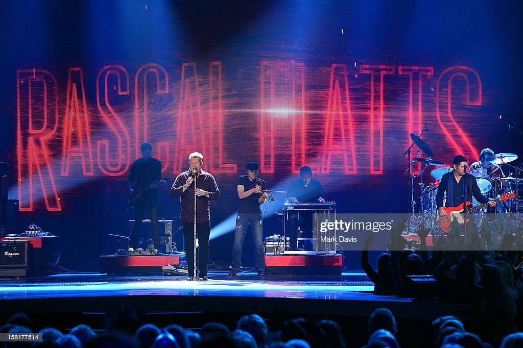 Music group Rascal Flatts performs onstage during the 2012 American Country Awards at the Mandalay Bay Events Center on December 10, 2012 in Las Vegas, Nevada.