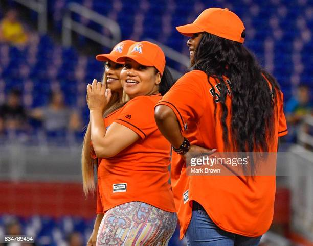 Music group SaltNPepa throw out the first pitch before the game between the Miami Marlins and the Colorado Rockies at Marlins Park on August 13 2017...