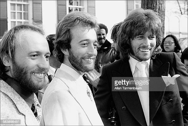 Music group the Bee Gees Maurice Robin and Barry Gibb arrive at Gracie Mansion for an awards ceremony and luncheon where they received get the Key to...