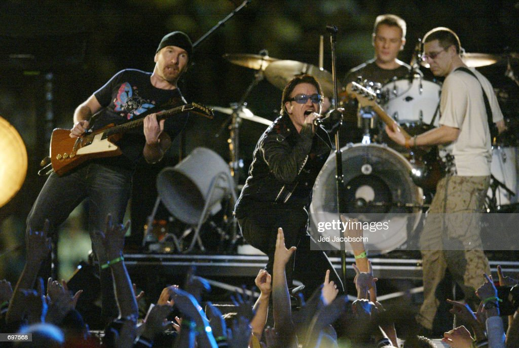 Music group U2 performs during halftime of Super Bowl XXXVI February 3, 2002 at the Superdome in New Orleans, LA. Super Bowl XXXVI is being played by the New England Patriots and the St. Louis Rams.