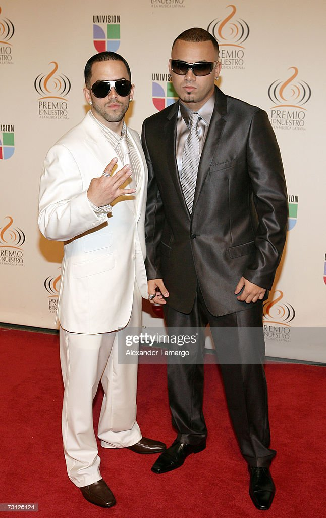 Music group Wisin y Yandel pose on the red carpet before Univision's Premio lo Nuestro Awards show on February 22 2007 in Miami Florida