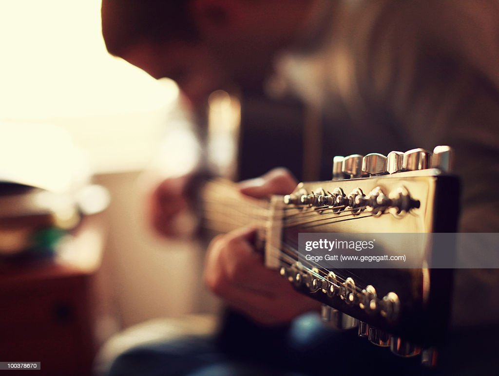 Music guitar player in a soft golden light