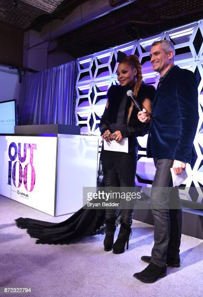 Music Icon Award honoree Janet Jackson and OUT Magazine EditorinChief Aaron Hicklin speak on stage during OUT Magazine #OUT100 Event presented by...