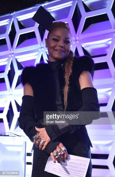 Music Icon Award honoree Janet Jackson celebrates on stage during OUT Magazine #OUT100 Event presented by Lexus at the the Altman Building on...