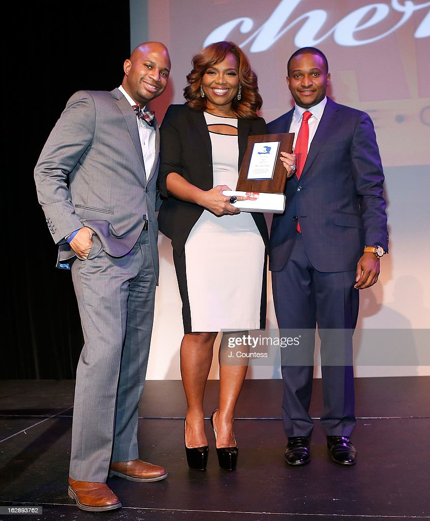 Music industry executive Mona Scott-Young (C) recieves an award from Fabrice J. Armand (R) during the 3rd Annual