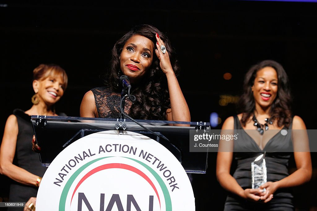 Music Industry executive Sylvia Rhone (L) and Acting Executive Director of the National Action Network Janaye Ingram (R) look on as Actress Valisia Lekae speaks after accepting her Triumph Award during The 4th Annual Triumph Awards at Rose Theater, Jazz at Lincoln Center on October 7, 2013 in New York City.