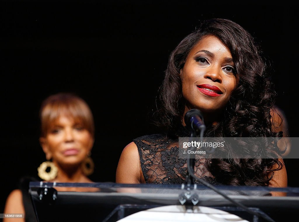 Music Industry executive Sylvia Rhone (L) looks on as Actress Valisia Lekae speaks after accepting her Triumph Award during The 4th Annual Triumph Awards at Rose Theater, Jazz at Lincoln Center on October 7, 2013 in New York City.