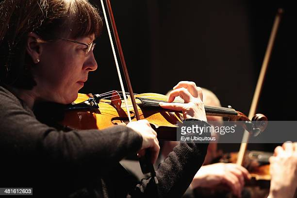 Music Instruments Strings Violin Detail of woman playing in orchestra