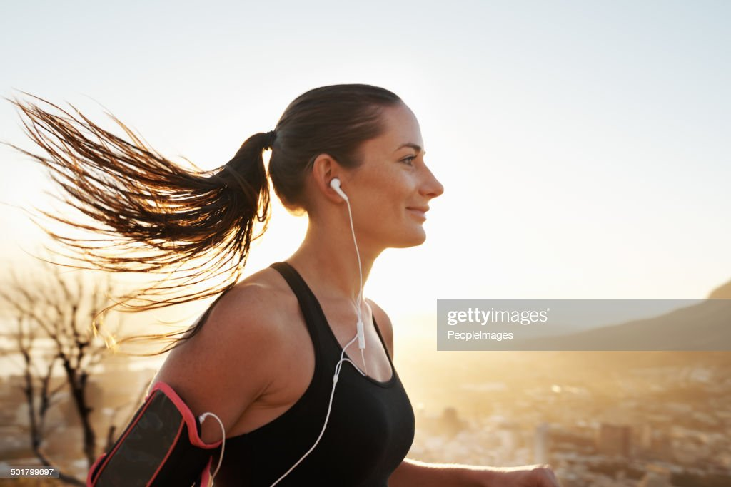 Music is the only motivation she needs : Stock Photo