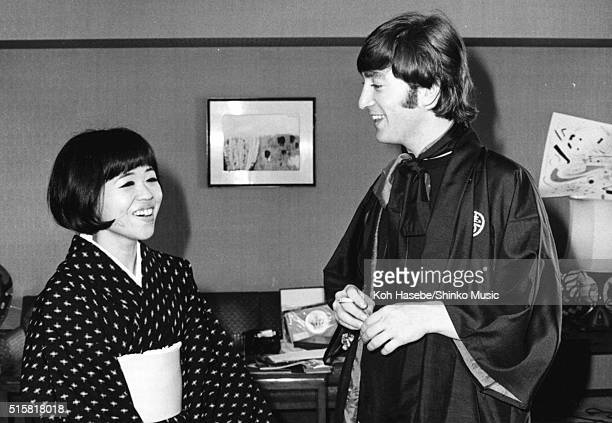 Music journalist Rumi Hoshika talks to John Lennon of The Beatles during an interview with Japanese music magazine 'Music Life' at Tokyo Hilton Hotel...